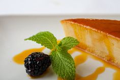 Flan : Manuel's signature coconut custard served with caramel sauce and fresh berries #manuels #mexicanrestaurant