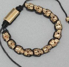 The Shambhala skull hand-woven bracelet, black. $7.50, via Etsy.