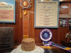 """Photo of the gold cheese award at the California State Fair. Credit: Kim von Aspern-Parker. Read more on the GenealogyBank blog: """"State Fair Food Fare: Strange Eats & Award-Winning Recipes."""" http://blog.genealogybank.com/state-fair-food-fare-strange-eats-award-winning-recipes.html"""