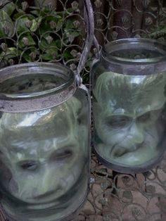 interior spaceLIFT - iS: Halloween Party Decorations: Buy masks at Dollar Store (I like glow in the dark ones) and put inside jars or lanter...