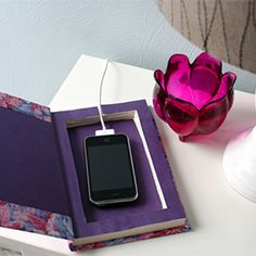 Use an old book as a clever place to hide your cell phone while it charges!