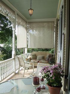 very traditional southern front porch with creamy porch floor. hmm, not sure how well that would hold up.