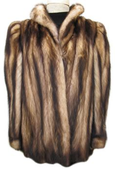 """Fitch Fur Jacket #F553; Approx. size range: 4 - 8; Excellent Condition; $975.  This is a gorgeous genuine natural fitch fur jacket with very dramatic and stunning markings. It is very soft and silky. It has a Raphael's label and features a small shawl collar and bracelet cuffs. It has two velvet-lined exterior pockets and closes with one hook and eye. The lining is solid gold-beige and there is a name monogram which is discreet as it is in the same color as the lining. Fitch fur is sometimes referred to as """"fitch mink"""" because the fur so closely resembles mink; it is a higher-end fur. Your purchase will include a copy of a recent appraisal which shows the present retail value of this jacket to be 4x our price! When you wear this remarkable fitch jacket, you will feel the eyes follow you as you walk through the room!"""