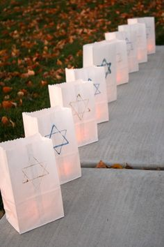 DIY Hanukkah Luminaries to Light up the Night- Instead of Star of David...Write J, O, R, D, A, N on each bag as it lines hall to the party room
