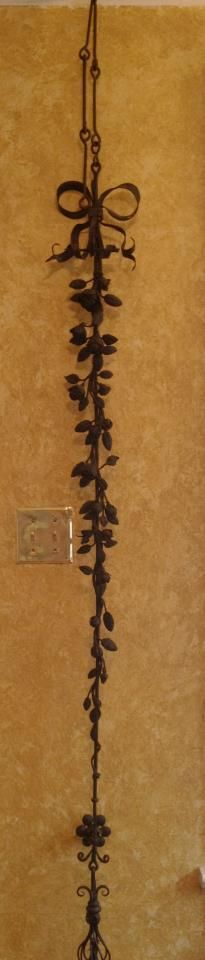 """StThis is what Stephanie says """"I bought this dusty old thing at an estate sale in Baton Rouge. It is a wrought iron butler bell pull. We think it dates to the Victorian era. I will also post a close up of the rose cascade. It is about 6 feet long excluding the chain. Anyone ever seen one before?"""