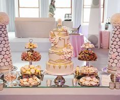 The dessert table was piled high with pink marshmallows, meringues, pink and lavender cookies and towers of lavender macarons from the Cake Opera Co.