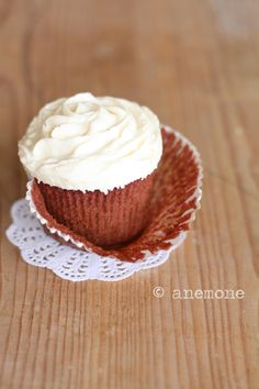 Classic, wonderfully fluffy frosting topped Red Velvet Cupcakes. #cupcakes #red #velvet #cake #food #dessert #baking #Valentines