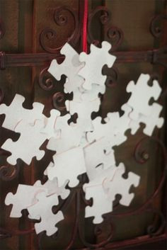 PUZZLE PIECE Snowflake Decoration!  Use the pieces from Puzzles that are missing too many!