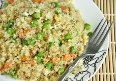 [Quinoa Fried Rice]  1 cup quinoa  1.5 cups water  2-4 tsp low sodium soy sauce  1-2 cloves of garlic, minced  1/8 tsp garlic powder [oh yes, I love my garlic! adjust to taste ♥]  1 cup of frozen or fresh veggies such as peas, carrots, and onion  1 large egg, optional  oil, butter, or earth balance for sauteeing  S+P to taste