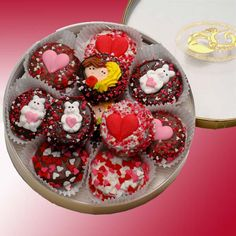 Double Dipped Oreos 16pc    This delightful Valentine Gift features our exclusive Gold Rimmed Acetate Round filled with delicious Valentine Belgian Chocolate Dipped Oreos®. Enrobed in delicious Belgian Chocolates- Dark Milk and/or White- they're decorated with candy Hearts and assorted hand-crafted Icing Decorations and nestled inside each Round on a lovely lace doily. SHOP NOW: www.Kimslabellabaskets.com