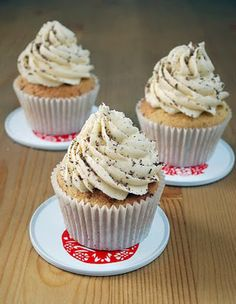 White Russian Cupcake - white cake infused with vodka and kahlua, topped with kahlua frosting and dusted with grated chocolate.