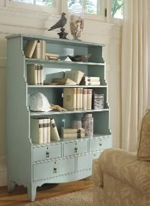 How pretty is this bookcase?  Love the color, love the lines and the proportion!