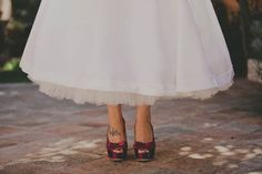 50s wedding dress and purple shoes