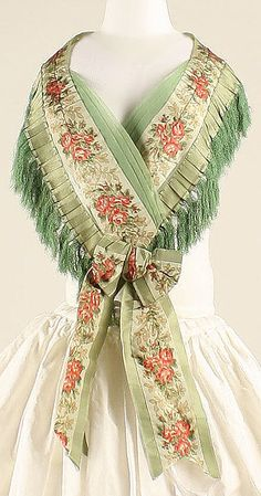 One of two silk and sheer silk a disposition fichus, which coordinate with evening dress. This fichu is trimmed with box pleated silk ribbon and silk fringe. American, ca 1856. MET