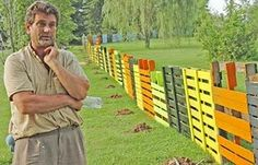 fun fence made of painted pallets