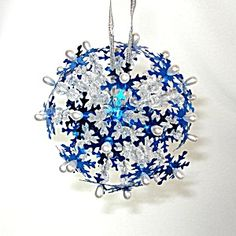 Snowflake Starburst Pin Beaded Sequined Christmas Ornament http://www.tias.com/snowflake-starburst-pin-beaded-sequined-christmas-ornament-676572.html