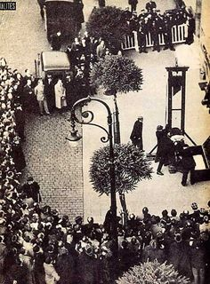 Eugene Weidmann is about to be beheaded in the last public execution to take place in France. June 17, 1939. [427x580] - Imgur