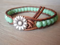 "Boho leather wrap bracelet, ""Country Girl"", Shabby chic, turquoise, silver daisy flower, featured in ETSY FASHION Ultimate Jewelry Guide. $39.00, via Etsy."