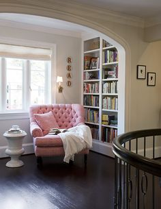 Great little reading alcove. Bookshelf, big chair, and blanket!