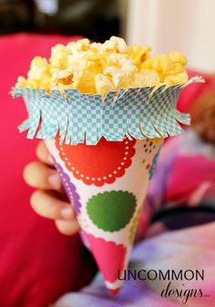 Popcorn treat cone ~ an upside-down party hat!!  Genius.  Fill with gourmet flavored popcorn from Tastebudspopcorn.com .