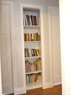 Love this idea of a built-in bookshelf in a hallway. Could be great to build in to the studs outside a guest room so they can just grab something that looks good to them.