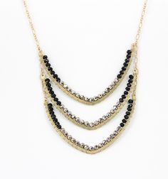 Designed with semi-precious gemstones, each stone is added by hand to this chevron necklace By Fotini Designs.