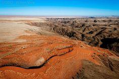 Namib Desert meets Fish River Canyon #Namibia. photo by Willem Vrey