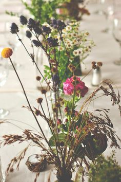 wildflower centerpieces, photo by Christina Block Photography http://ruffledblog.com/epping-forest-yacht-club-wedding #weddingcenterpieces #wildflowers