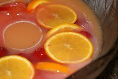 """Orange Strawberry punch with fresh orange and strawberry ice ring. So good! My Recipe: (per punch bowl) 1 can frozen orange juice w/ no pulp, 1 can frozen """"strawberry breeze"""" juice (found it at Wal-mart), and 2 liter of Sprite. Mix all together in a punch bowl!!"""