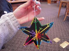 Making scratch art snowflake ornaments since we don't get any snow down here! Tomorrow at Los Altos story time.