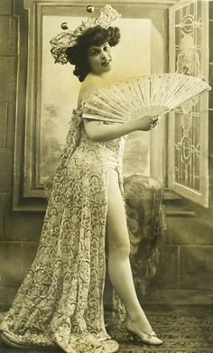 Showgirl c.1903 with a fan