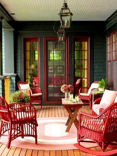 Green siding, red windows and door