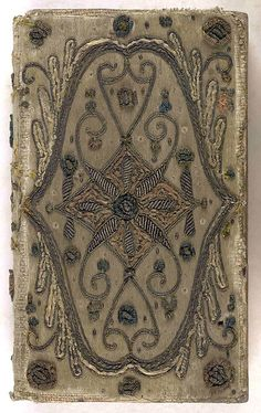 17th century embroidered satin book cover with silver threads.    Embroidered satin book cover  with silver threads.  Good Newes from Heaven.  (London, 1631)  Collection: The British Library