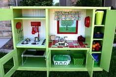 upcycled entertainment center -diy play kitchen sets from recycled furniture