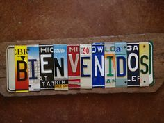 BiENVENIDOS upcycled welcome license plate sign for your house kitchen cuchina casa TOMBOYart license plate upcycled recycled. $225.00, via Etsy.