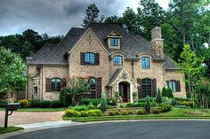 Lovely looking Center Hall Colonial with a Horseshoe Driveway