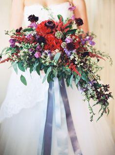 Beautiful bold bouquet with trailing ribbons Photography: Marissa Lambert - marissalambertphotography.com
