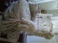 Lace chair covered with lace trims and doilies by a very talented friend