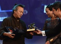 "Korean director Kim Ki-Duk receives the Golden Lion for Best Film ""Pieta"" Reverso watch bearing a lacquered engraving of the lion that symbolises Venice, 8th September"