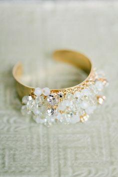 Fun cuff bracelet | See the wedding on SMP: http://www.stylemepretty.com/2013/12/20/davies-manor-plantation-wedding/  Photography: Annabella Charles