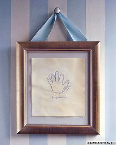 Growing Hands - trace baby's hand on the same piece of paper every year...