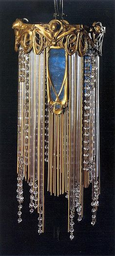 """Hector Guimard, Chandelier, 1909    """"Chiselled golden bronze, coloured glass, beads and glass tubes, brass and copper structure. 41 x 19 cm. Musée d'Orsay, Paris."""
