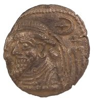 "Ancient Persian.   Silver Elymais tetradrachm coin with a bearded portrait.  Size: 1""  Date: 200 AD"