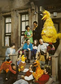 Everything's A ok- but OLD! Oscar's orange, and that's Jim Henson with Ernie.