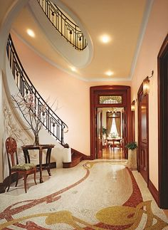 An elliptical stair and mosaic floor in the entrance hall of a townhouse in a landmark NYC building. Architect Alan Wanzenberg  -  Interior Design Vladimir Alexandrovich Fabrikov.
