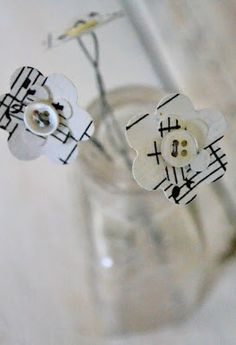 button flowers made with paper punch flowers.  Use sheet music, old books