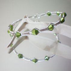 Green Wire Wrapped Bracelet #etsy #etsyfollow #green #wire #wrapped #bracelet #jewelry #silver #gift #elegant #handmade #bridesmaid $16.00 ---- I have some sapphire beads that would look gorgeous in a style like this!