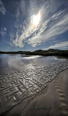 African languages are inked into the Lead Grey sand of this ephemeral work of art by Andrew van der Merwe.