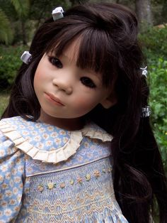 Hand smocked this dress, part of a 4 piece set, also sold this one on ebay years ago. These Himstedt dolls are beautiful. I no longer have any dolls or do any sewing......
