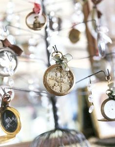 Creative Chirstmas ornament idea: recycle old photos and pocket-watches to create unique antique ornaments.